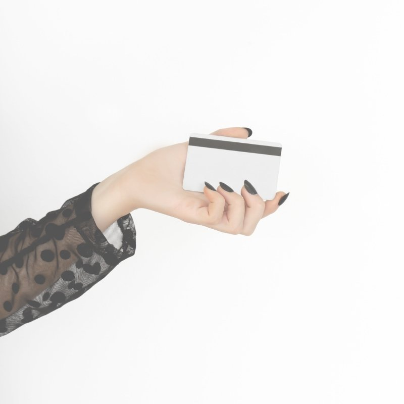 Hand holding a credit or debit card