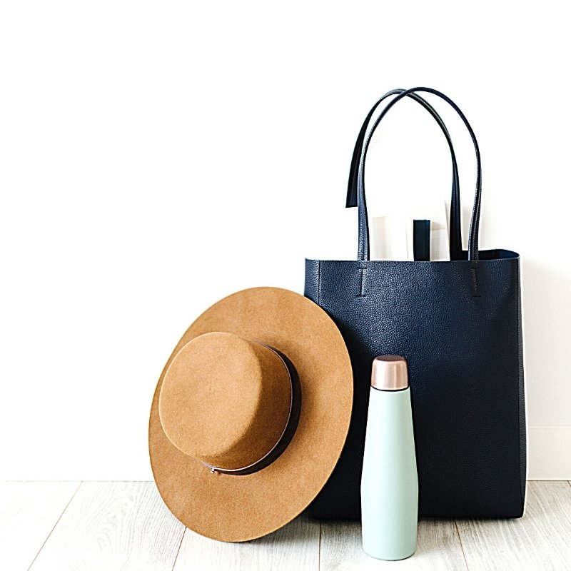Shopping bag, hat, and water bottle