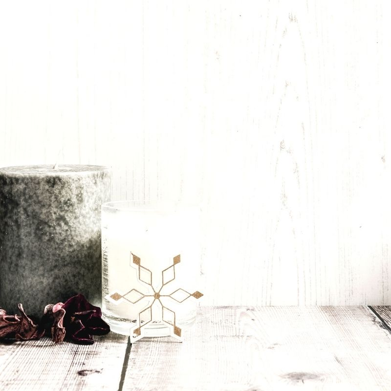 Grey candle and snowflake decoration