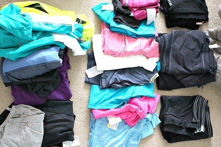 Fitness clothes laid out in like piles