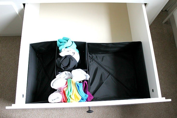Filling a drawer with sports clothes