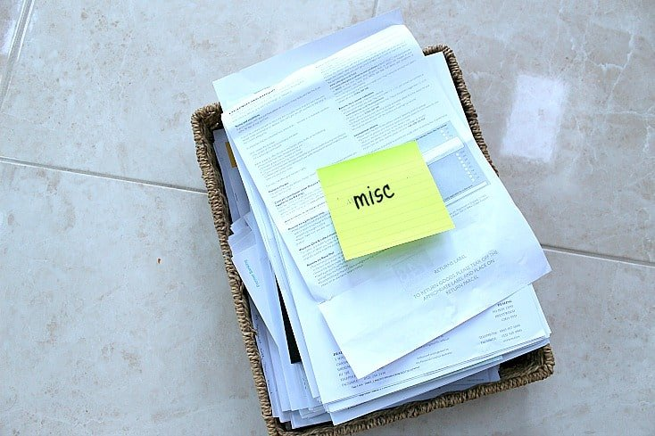 Basket of paperwork with post it note saying MISC on top