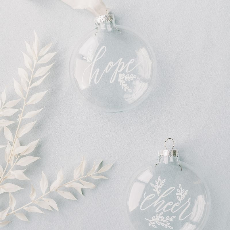 White and clear baubles with writing on