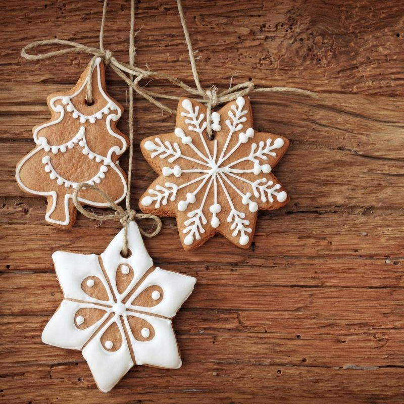 Edible ginerbread Christmas tree decorations with white icing