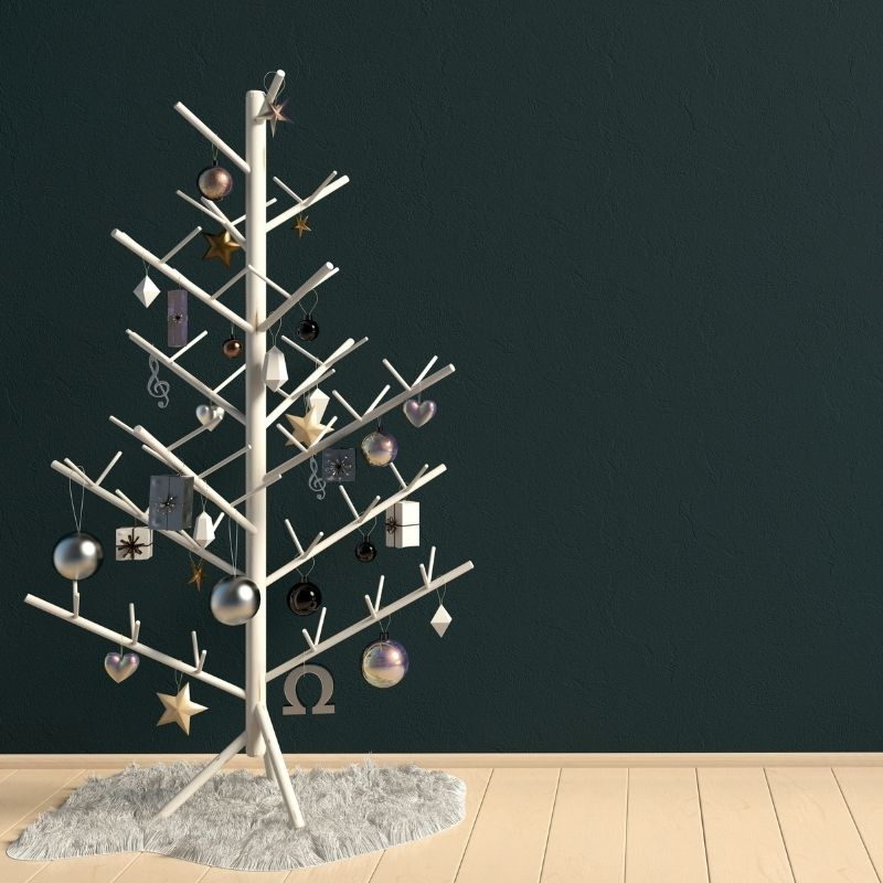 Wooden stick Christmas tree with baubles on