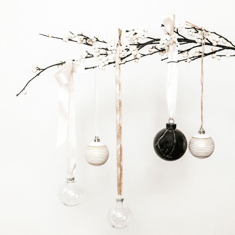 Baubles hanging from ribbons on twig