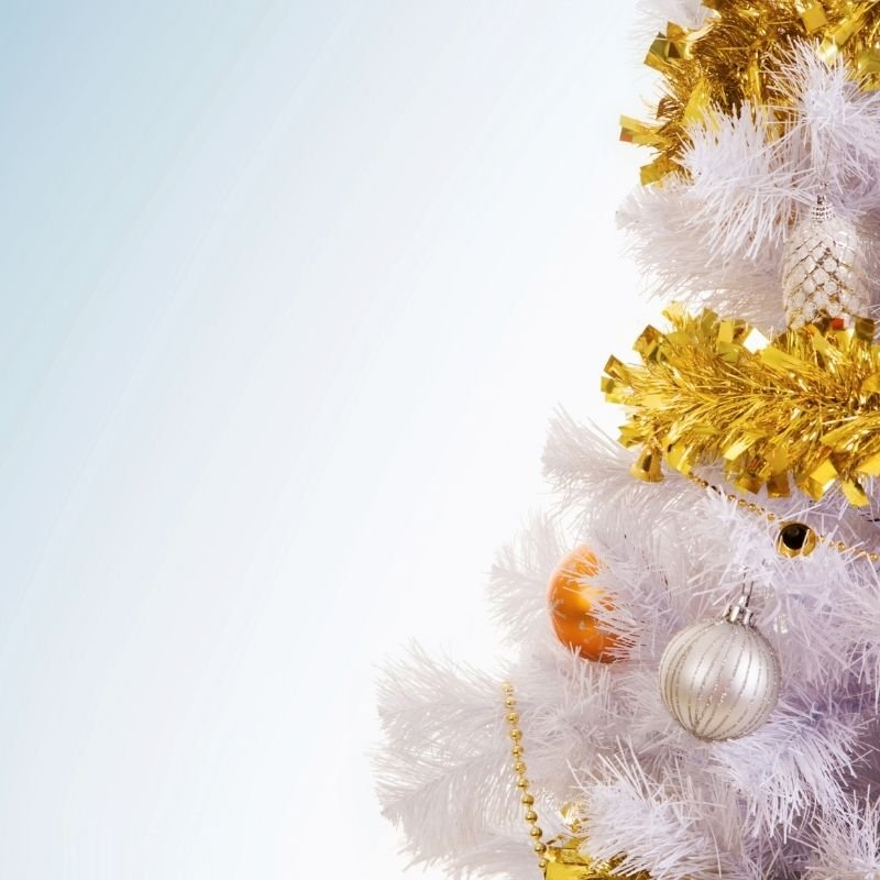 White Christmas tree with gold tinsel