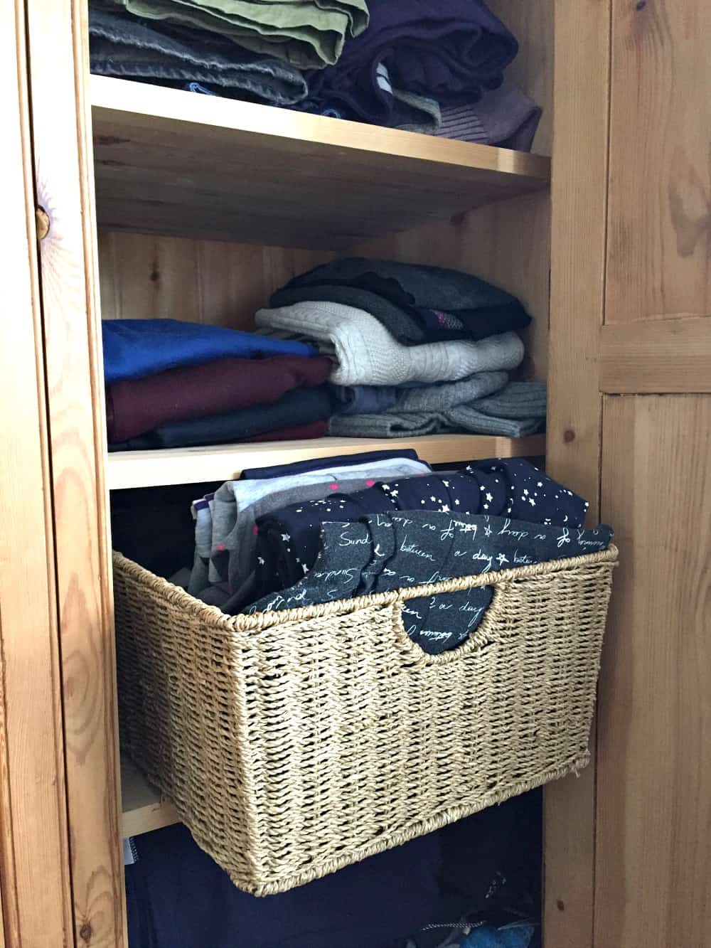 Baskets used as storage in a free standing wardrobe