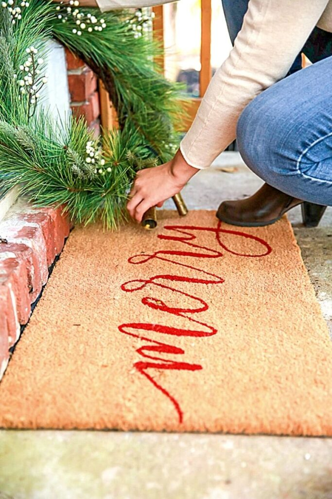 Sisal welcome mat with Merry written on it in red