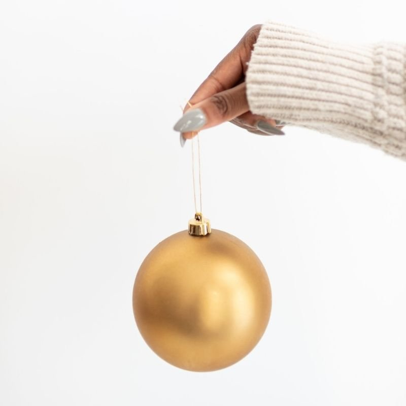 Lady holding a gold bauble