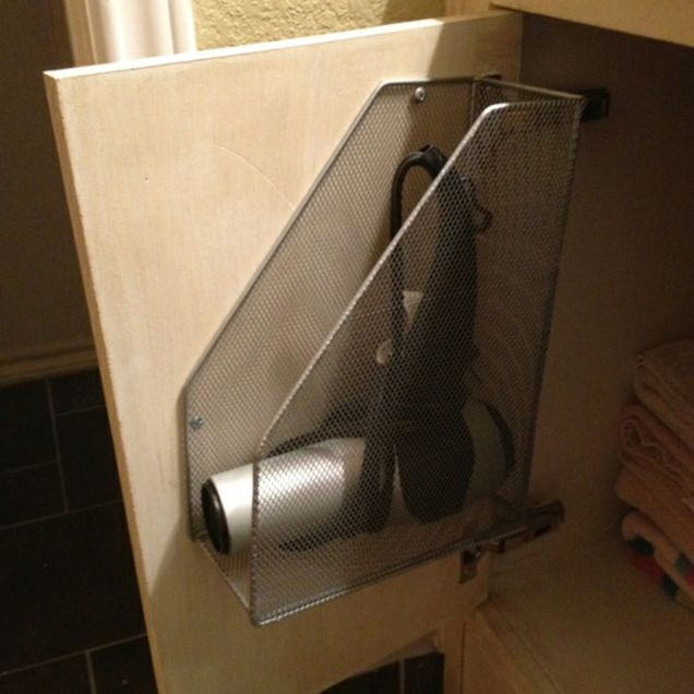 Bathroom cabinet door storage with magazine folders