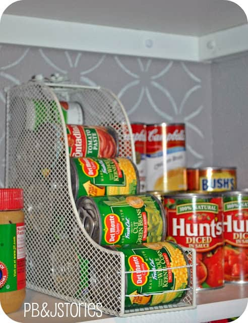 Using magazine files for storing cans in a kitchen cabinet