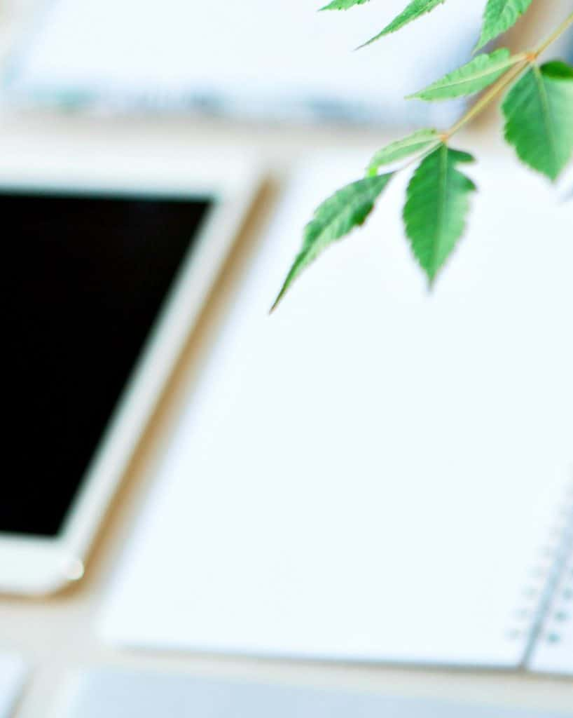 Tablet with notepaper and greenery