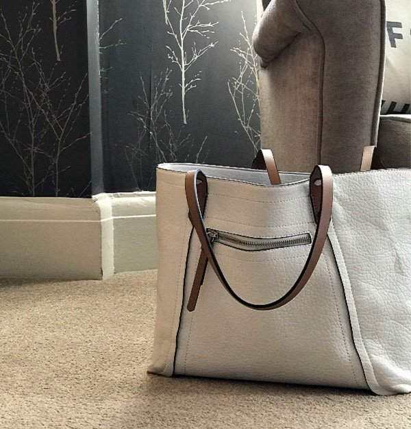 White handbag with brown handles