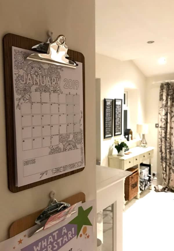Printable Colouring In Monthly Planner Pages on a Clipboard