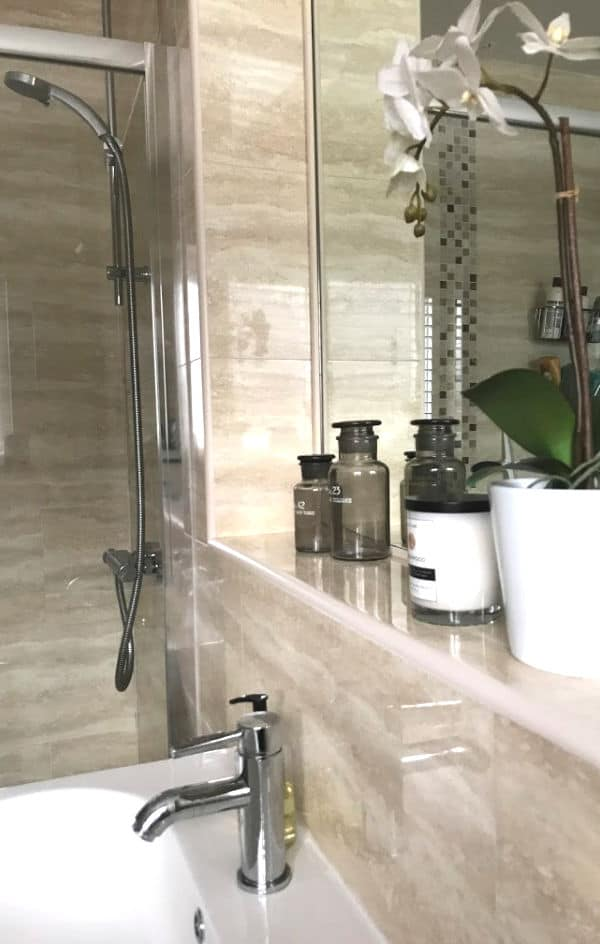 Close up of bathroom shelf with decorative items on