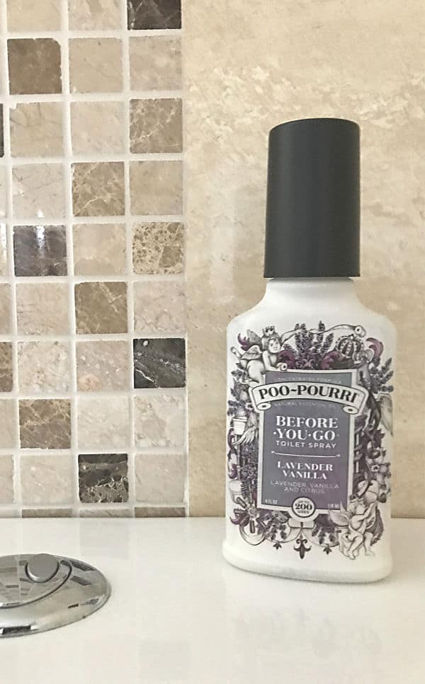 Spray bottle of Poo Pourri on top of a toilet