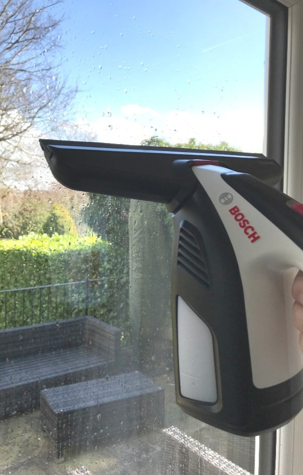 Bosch GlassVAC cleaning a window