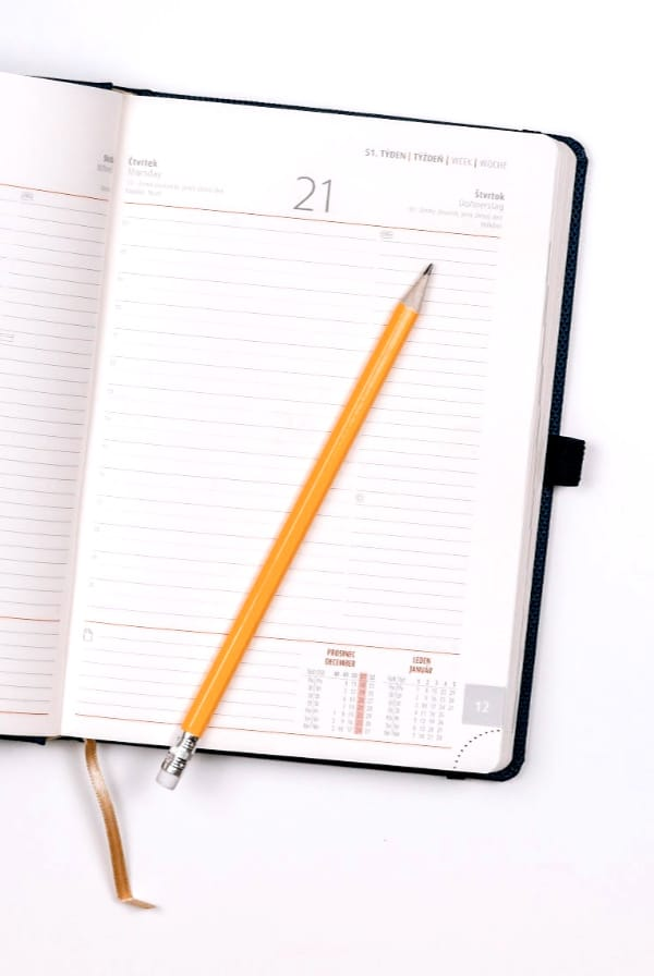 Planner open with yellow pen