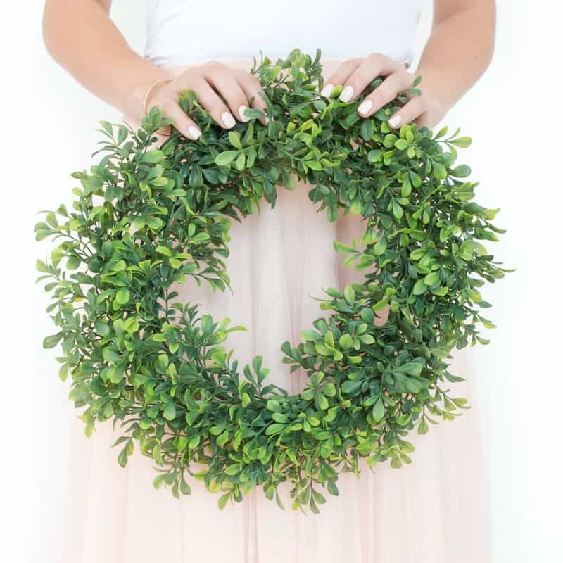 Lady holding a wreath