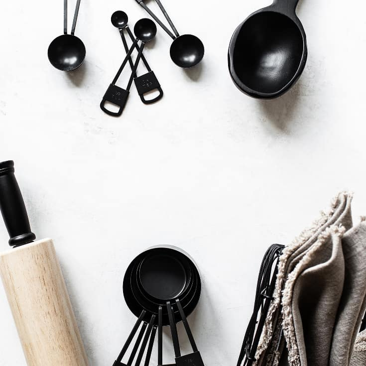 Selection of Black Kitchen Utensils on a White Background