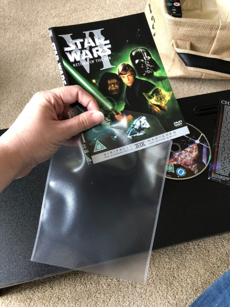 putting dvd cover into dvd sleeve