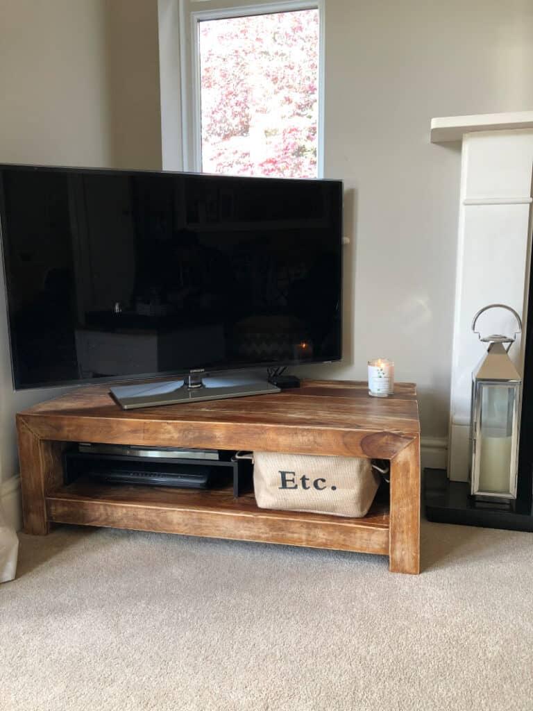 TV unit with basket storage for DVDs