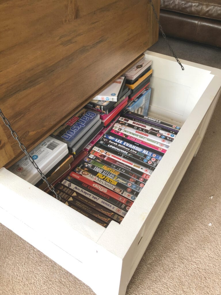 DVDs in storage coffee table