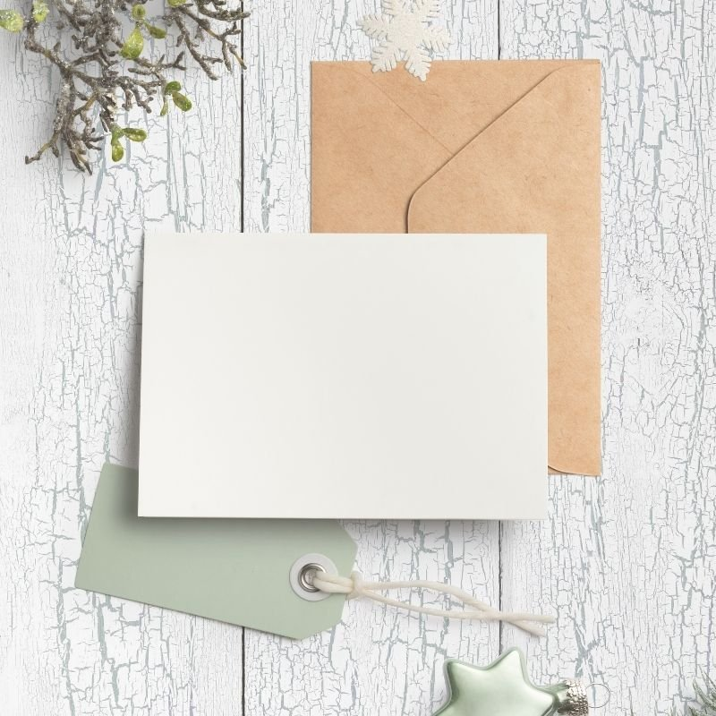 Christmas card flatlay in greens and whites