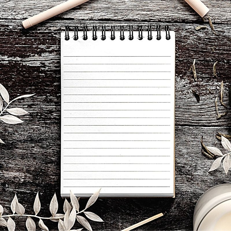 Notepad on wooden background
